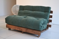 A green tri fold futon mattress on wooden frame