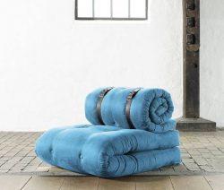 A blue roll up mattress