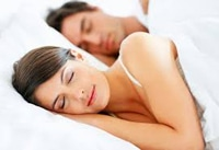 A Young Couple Sleeping On A Comfortable Mattress