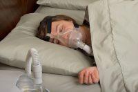 A woman with a sleep apnea machine
