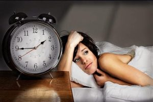 A woman struggles to sleep