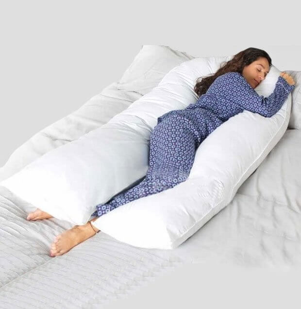 Pregnant woman using a full body pillow