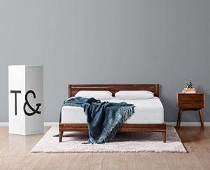 A t&N mattress in a box beside a bed