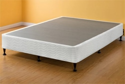 A box spring with legs in an empty room