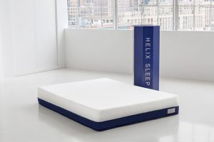 A Helix mattress beside its box