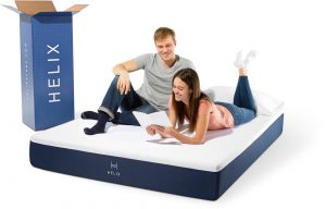 A couple laying on their new mattress from Helix Sleep