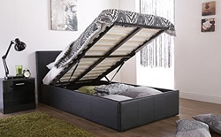 An ottoman storage bed lifted to expose the underneath