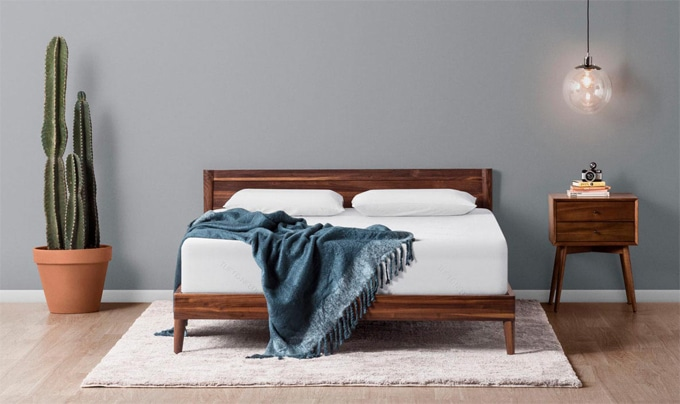 A Tuft and Needle mattress on a platform bed