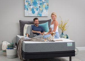 A couple and their dog on a new Ghostbed mattress