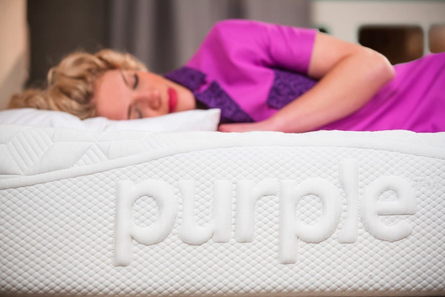 A woman sleeping on her Purple Bed