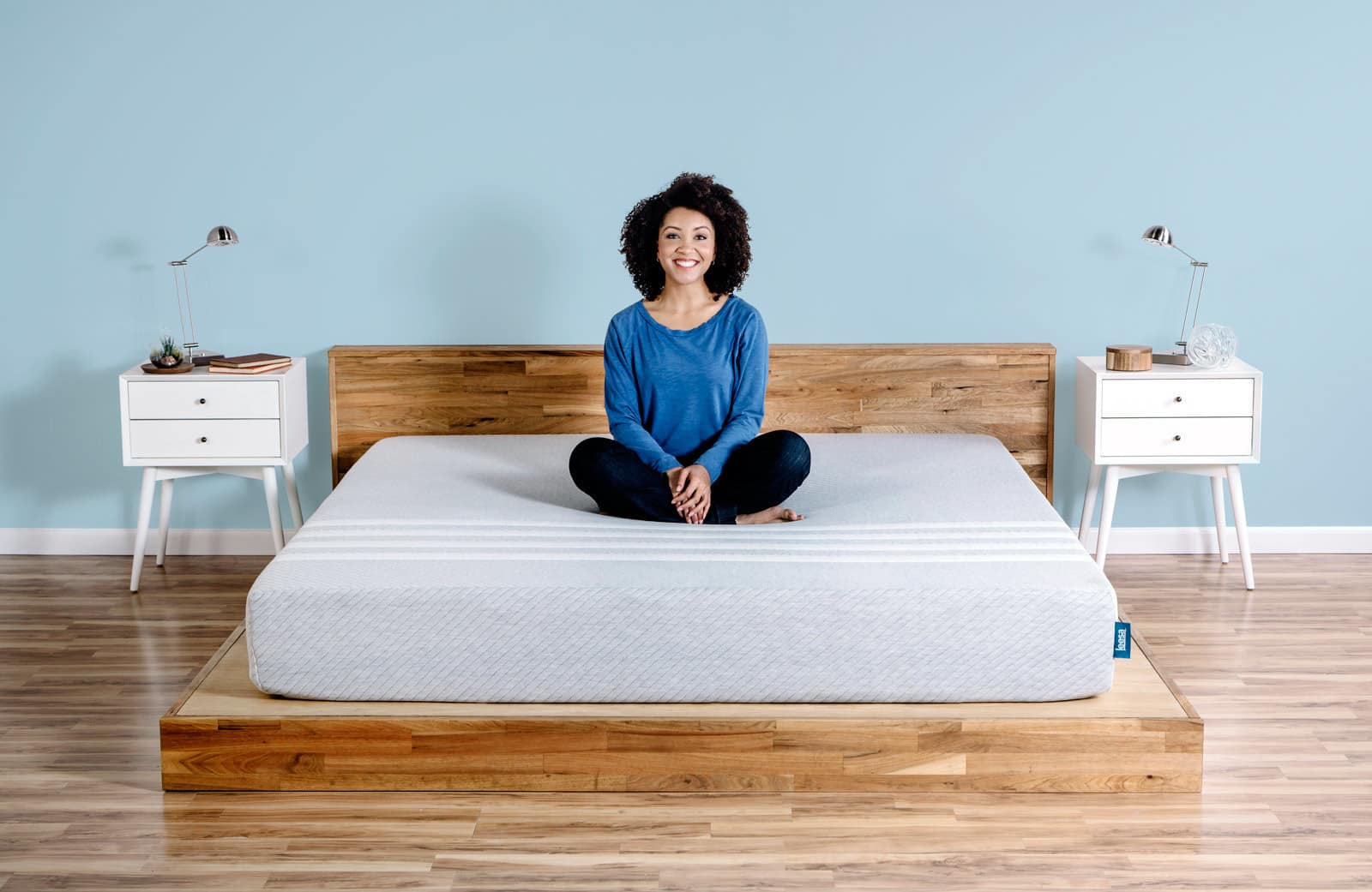 Lady sitting on her Leesa mattress