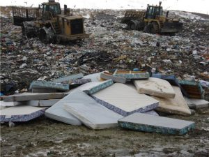 Pile of old mattresses in a landfill site