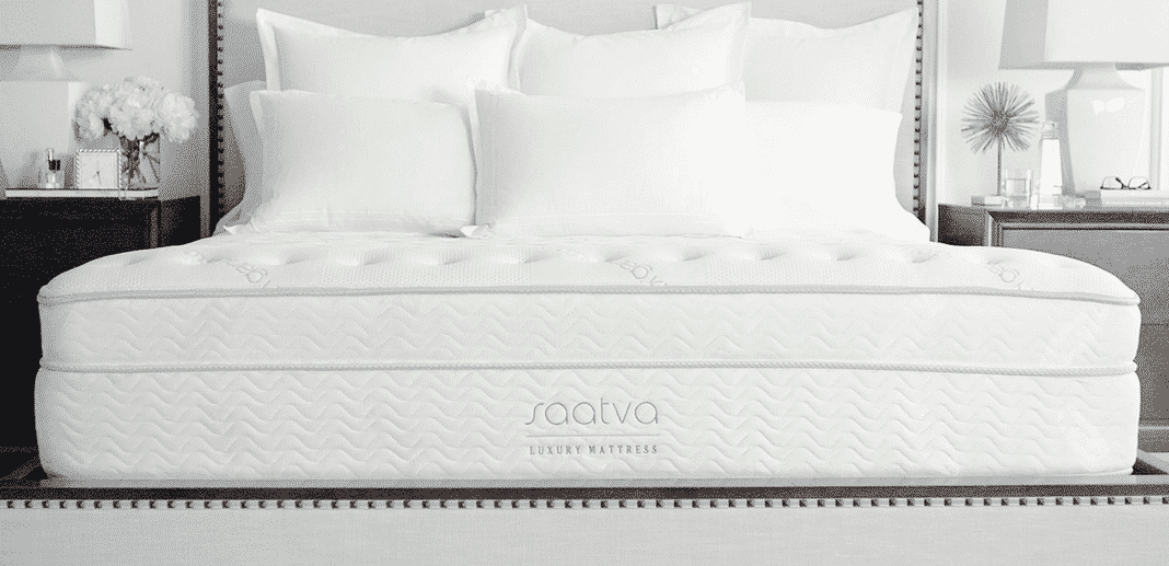 A Saatva mattress on a platform bed