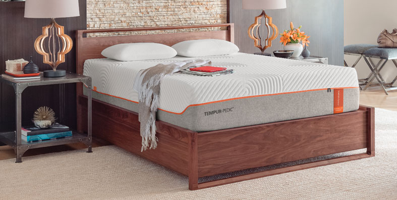 Tempurpedic mattress on a wooden slatted bed