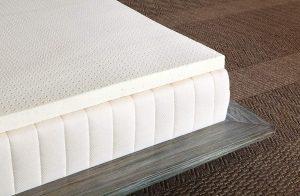 A latex topper on a mattress