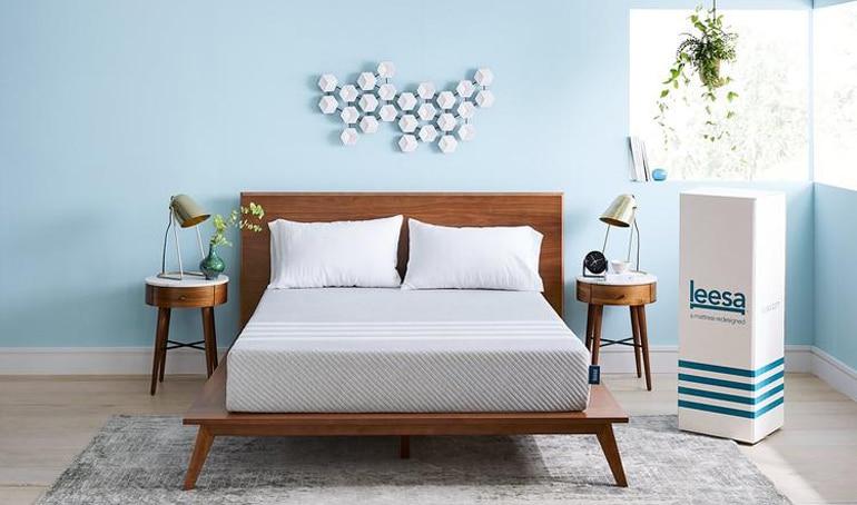 The Leesa Mattress on a wooden platform bed
