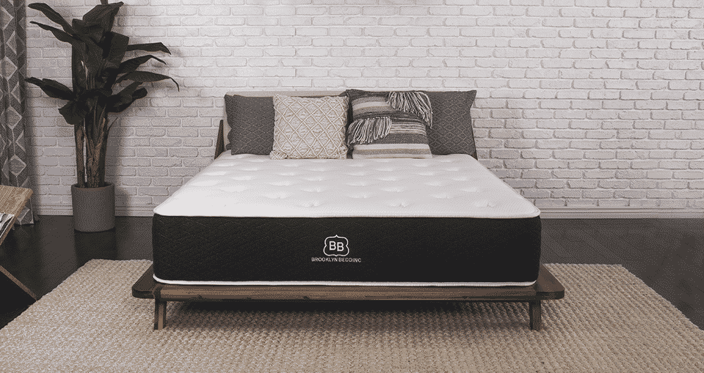 A Brooklyn Bedding Signature on a platform bed