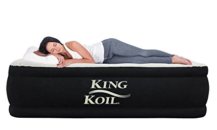 A woman laying on a luxury mattress