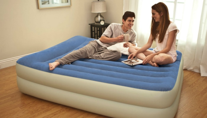 A couple talking on their air bed
