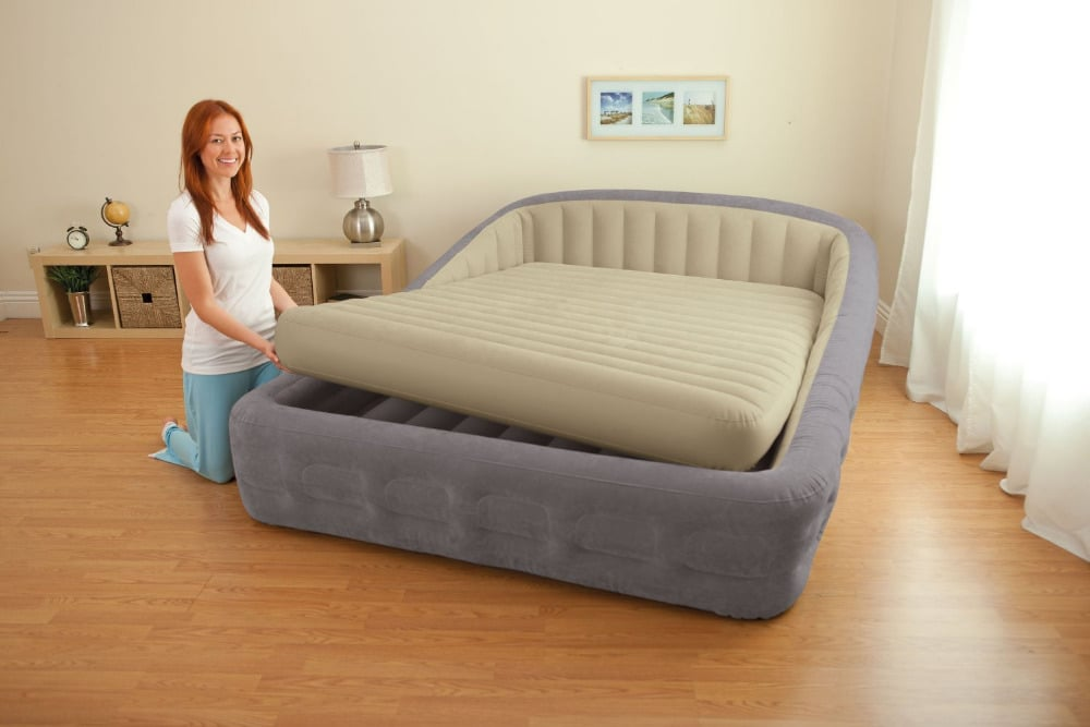 A lady getting her air bed ready