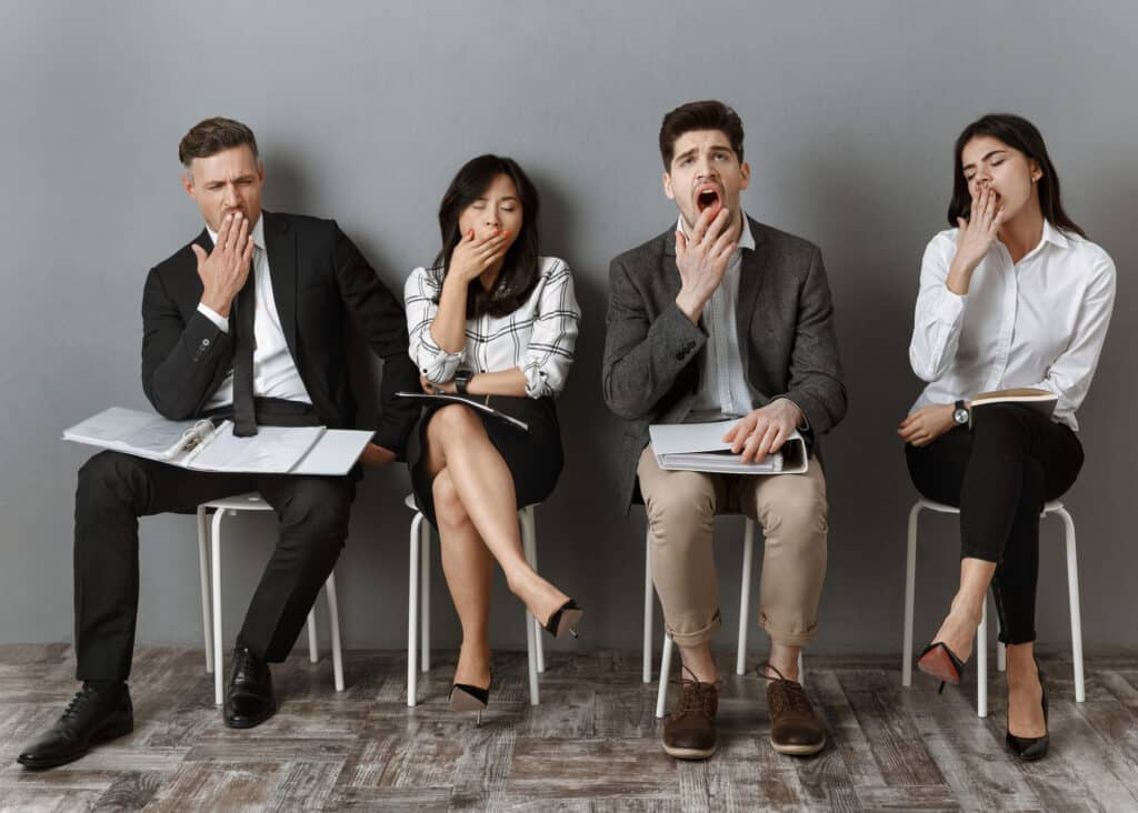 A group of people all yawning at the same time