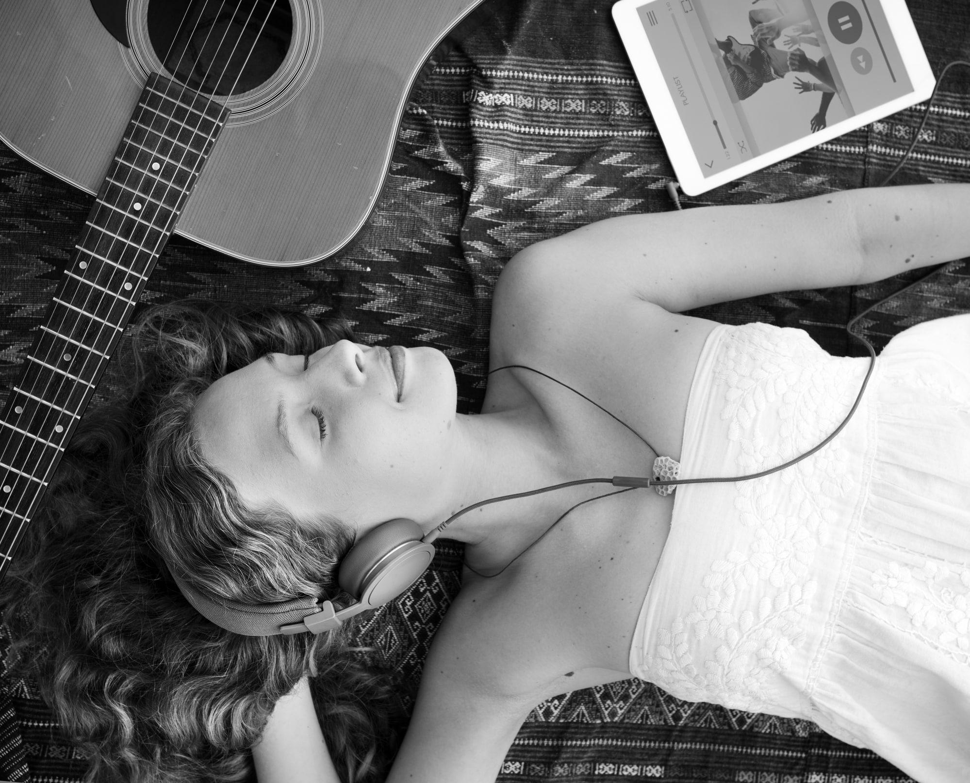 Playing music through her headphones while asleep